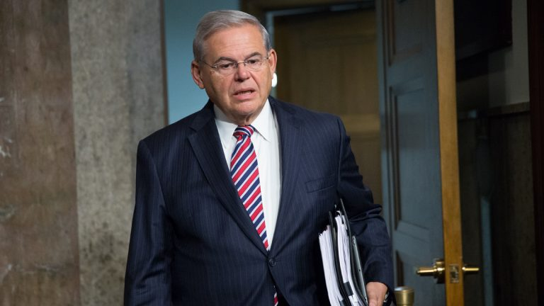 Sen. Bob Menendez, D-New Jersey, arrives before Secretary of State John Kerry, Secretary of Energy Ernest Moniz, and Secretary of Treasury Jack Lew arrive to testify at a Senate Foreign Relations Committee hearing on Capitol Hill, in Washington, Thursday, July 23, 2015, to review the Iran nuclear agreement. (Andrew Harnik/AP Photo)
