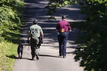 Investigators walk up a blocked off drive way, in, Solebury Township, Pa., on Wednesday, July 12, 2017. (Matt Rourke/AP Photo)