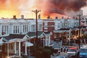 Rowhouses in Philadelphia burn after authorities dropped a bomb on the MOVE house in May 1985.