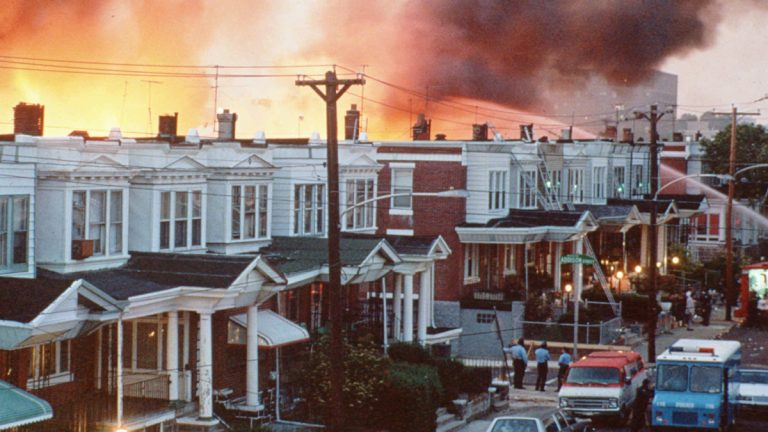 Row houses in Philadelphia burn after authorities dropped a bomb on the MOVE house in  May 1985. (AP Photo, files)