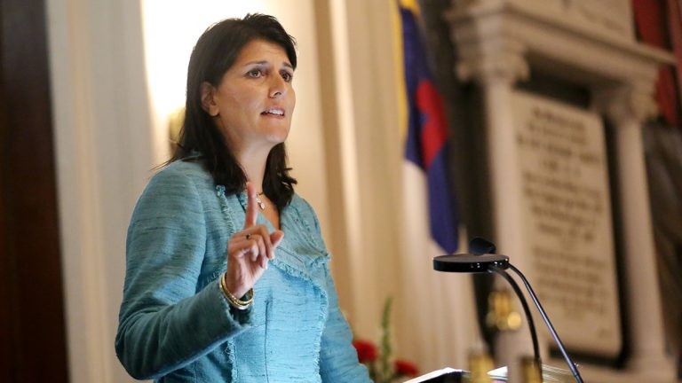 In this June 18, 2015, file photo, South Carolina Gov. Nikki Haley addresses a full church during a prayer vigil held at Morris Brown AME Church for the victims of the shooting at Emanuel AME Church in Charleston, S.C. Haley said the shooter who gunned down nine people inside a historic black church in Charleston should be put to death. (Grace Beahm/The Post And Courier via AP, Pool, File)