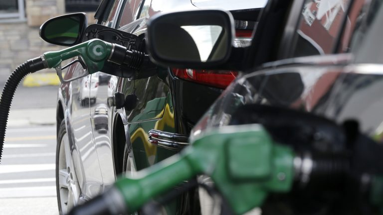 Nozzles pump gas into vehicles at a BP gas station (Julio Cortez/AP)