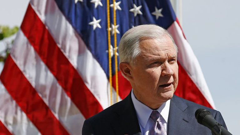 Attorney General Jeff Sessions speaks at a news conference after touring the U.S.-Mexico border on April 11. The Justice Department is warning so-called