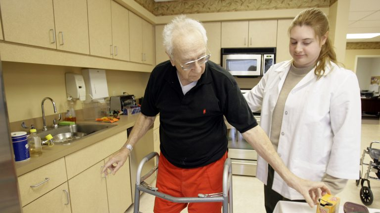 A man works with an occupational therapist during a therapy session in Hatboro, Pennsylvania. (Matt Rourke/AP Photo)