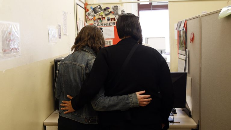 Carolyn Caton, left, and Noelle Foizen wait for their marriage license at the Philadelphia Marriage Bureau in City Hall, Tuesday, May 20, 2014, in Philadelphia. Pennsylvania's ban on gay marriage was overturned by a federal judge Tuesday. (Matt Slocum/AP Photo)