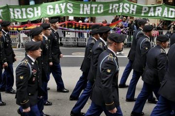 Marchers walk past a group of protesters during the St. Patrick's Day Parade in New York, Tuesday, March 17, 2015. The group was protesting the exclusion of LGBT groups from the parade. (AP Photo/Seth Wenig)