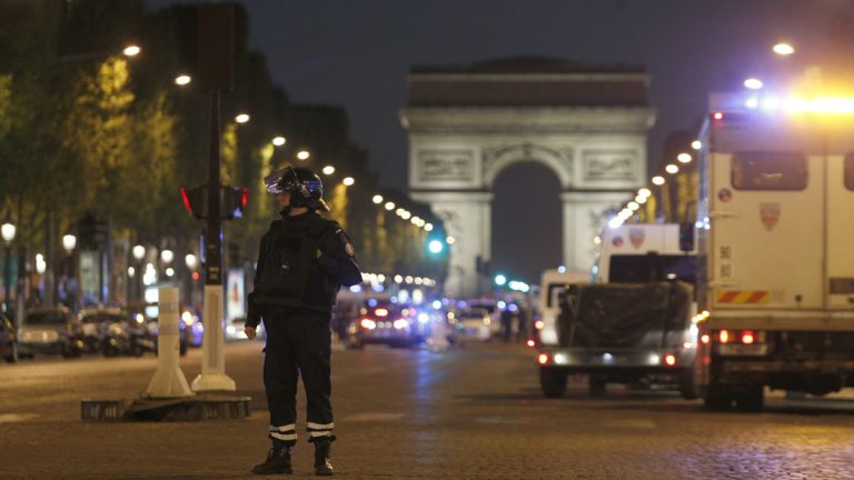 A police officer stands guard after a fatal shooting on the Champs Elysees in Paris, France, Thursday, April 20, 2017. Paris police: Attacker shot police guarding metro near Champs-Elysees but was shot dead; 1 police killed, 1 wounded. (Thibault Camus/AP Photo)