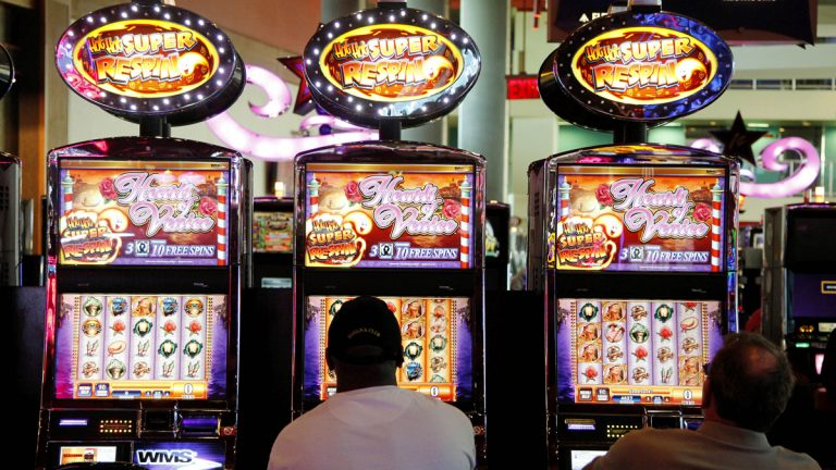 In this May 24, 2012 file photo, patrons play the slot machines at Harrah's Casino in Chester, Pa. (Alex Brandon/AP Photo)