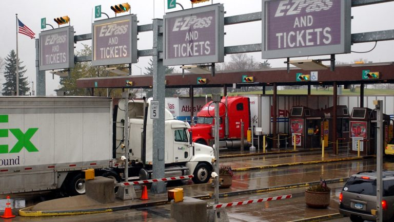 Trucks and cars move through a Pennsylvania Turnpike toll plaza in Carlisle Pa. (Carolyn Kaster/AP Photo, file)