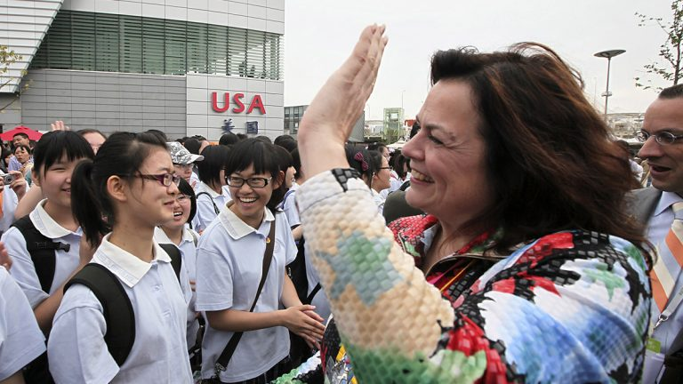 Allison Vulgamore,  Philadelphia Orchestra's president and CEO, pictured in this May 2010 file photo greeting Chinese students from local girl's middle school in Shanghai, China, is stepping down. (Eugene Hoshiko/AP Photo)