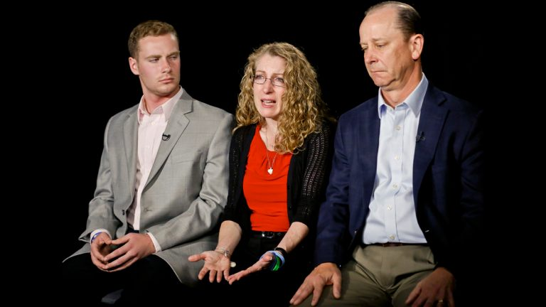Evelyn Piazza, center, seated with her husband James, right, and son Michael, left, speaks during an interview on Monday May 15, 2017, in New York. The Piazza's talked about Timothy Piazza, 19, a brother, son and Penn State sophomore who died in February after he was put through a hazing ritual at his fraternity house and forced to drink dangerous amounts of alcohol in a short amount of time. (Bebeto Matthews/AP Photo)