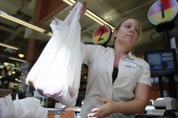 The goal of New Jersey's proposed 5-cent fee on paper and plastic bags is to cut down on plastic that ends up as litter and clogs waterways. (AP file photo)