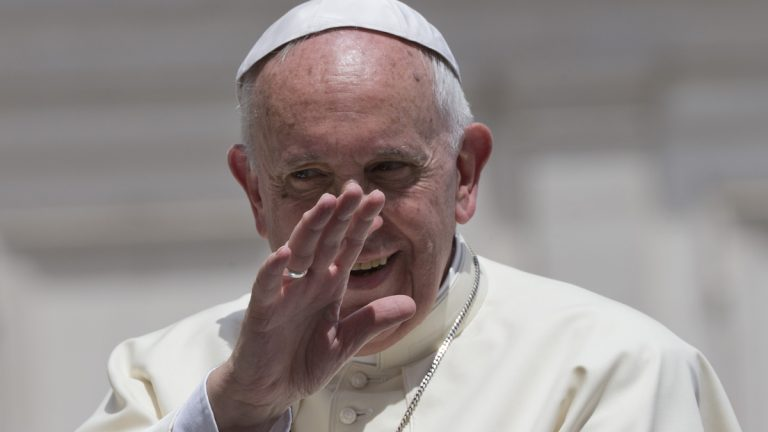 Pope Francis waves as he leaves at the end of his weekly general audience, in St. Peter's Square at the Vatican, Wednesday, June 17, 2015. (Andrew Medichini/AP Photo)