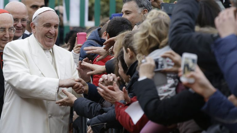 Pope Francis greets admirers last month in Rome. (Gregorio Borgia/AP Photo)