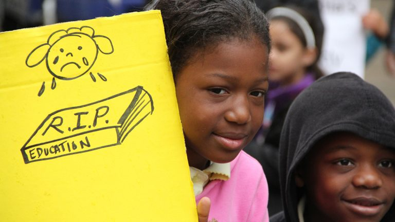 Emani Edwards, 9, and Khyair Goodwin, 7, participate in a protest against school budget cuts at Philadelphia City Hall on April 29, 2013. (Emma Lee/for NewsWorks)