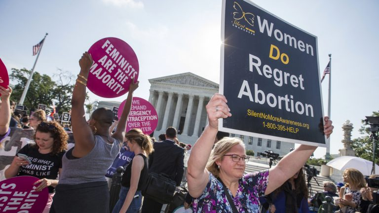 Activists demonstrate in front of the Supreme Court in Washington Monday as the justices close out the term with decisions on abortion, guns, and public corruption. (J. Scott Applewhite/AP Photo)