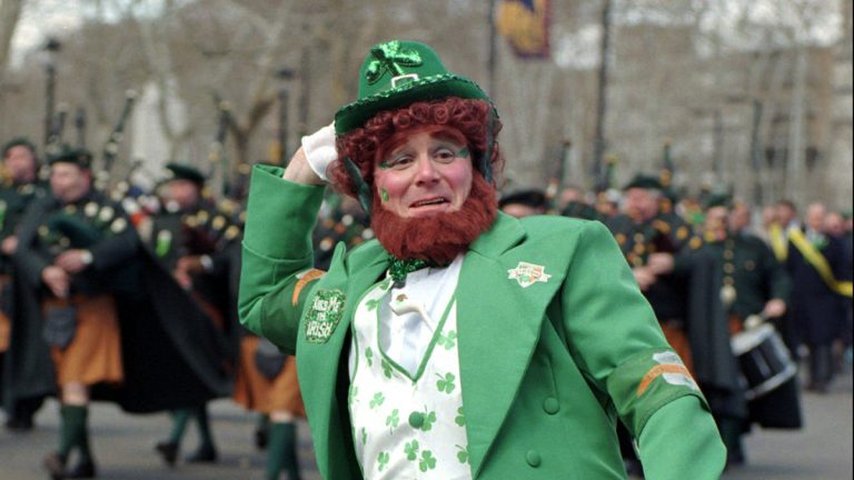 In this file photo, retired Philadelphia police Sgt. Chuck Warren struts down the Benjamin Franklin Parkway in Philadelphia dressed as a leprechaun for the annual St. Patrick's Day Parade. (Jim Graham/AP Photo, file)