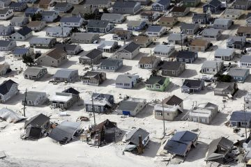 In this aerial photo, sand fills the streets in the wake of Superstorm Sandy, Wednesday, Oct. 31, 2012, along the central Jersey Shore. (Mike Groll/AP Photo)