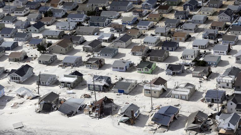 In this aerial photo, sand fills the streets in the wake of Superstorm Sandy, Wednesday, Oct. 31, 2012, along the central Jersey Shore, N.J. (Mike Groll/AP Photo)