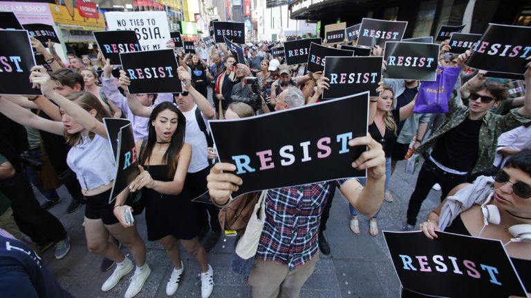 Protestors gather in Times Square, Wednesday, July 26, 2017, in New York. President Donald Trump declared a ban Wednesday on transgender troops serving anywhere in the U.S. military, catching the Pentagon flat-footed and unable to explain what it called Trump's 'guidance.' (Frank Franklin II/AP Photo)