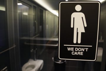 In this photo taken Thursday, May 12, 2016, signage is seen outside a restroom at 21c Museum Hotel in Durham, N.C. North Carolina is in a legal battle over a state law that requires transgender people to use the public restroom matching the sex on their birth certificate. The ADA-compliant bathroom signs were designed by artist Peregrine Honig. (Gerry Broome/AP Photo)