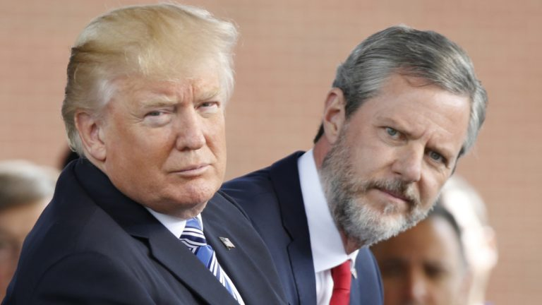 President Donald Trump, (left), and Liberty University president, Jerry Falwell Jr., (right), during commencement ceremonies at the school in Lynchburg, Va., Saturday, May 13, 2017. (Steve Helber/AP Photo)