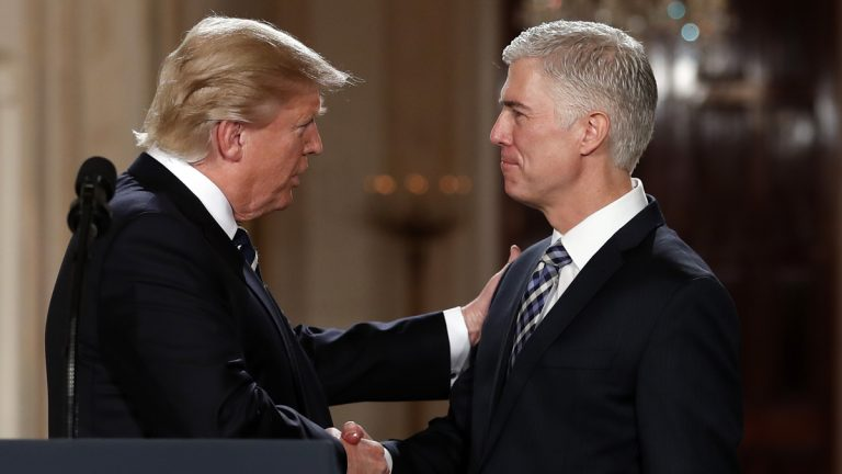 President Donald Trump shakes hands with 10th U.S. Circuit Court of Appeals Judge Neil Gorsuch, his choice for Supreme Court associate justice in the East Room of the White House in Washington, Tuesday, Jan. 31, 2017. (Carolyn Kaster/AP Photo)