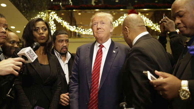 Republican Presidential candidate Donald Trump (center), joins a group of African-American religious leaders to speak to reporters in New York, Monday, Nov. 30, 2015. Trump met with a coalition of 100 African-American evangelical pastors and religious leaders in a private meeting at Trump Tower. (Seth Wenig/AP Photo)