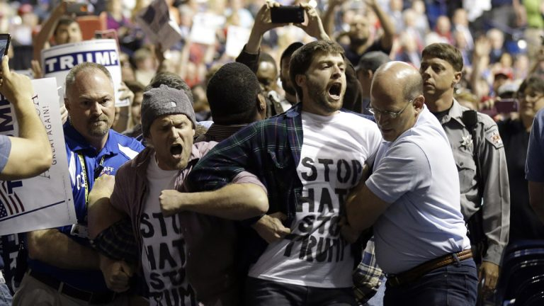 Protesters are removed as Republican presidential candidate Donald Trump speaks during a campaign rally in Fayetteville