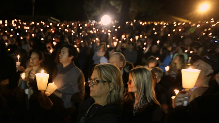 Community members gather for a candlelight vigil for those killed in a shooting at Umpqua Community College in Roseburg, Oregon, Thursday. (Rich Pedroncelli/AP Photo)