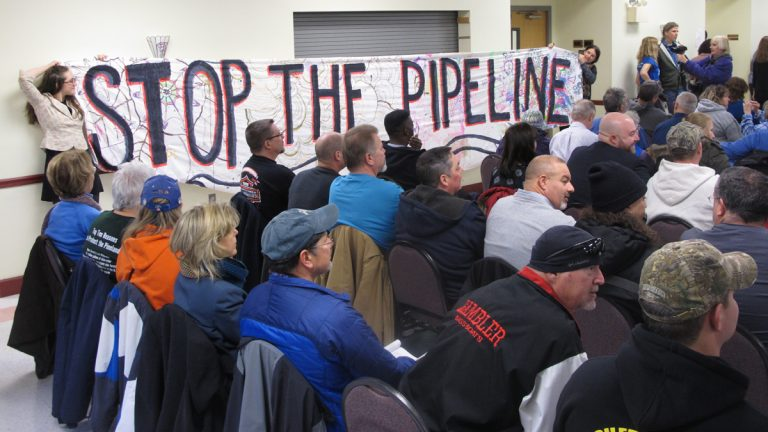 Opponents of a natural gas pipeline proposed to run through the federally protected Pinelands in New Jersey unfurl a banner against it during a public hearing on the proposal in Pemberton, N.J. on Tuesday Jan. 24, 2017. Environmentalists fear the pipeline will damage the fragile forest, but business and labor groups say it will create jobs and increase energy reliability. (Wayne Parry/AP Photo)