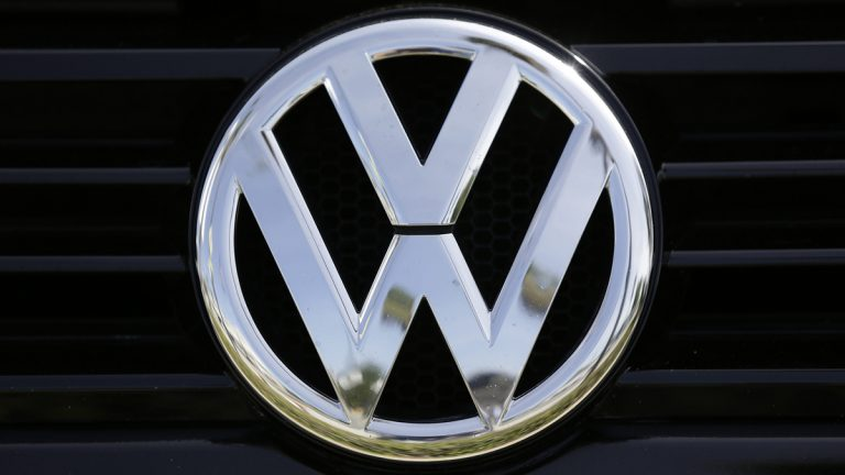 In this Sept. 21, 2015, file photo, a Volkswagen logo is seen on car offered for sale at New Century Volkswagen dealership in Glendale, Calif. (Damian Dovarganes/AP Photo, File)