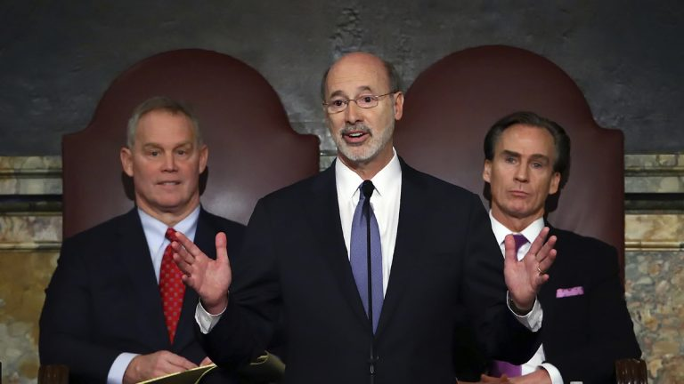 In this Feb. 9, 2016, file photo, Gov. Tom Wolf, (center), delivers his budget address for the 2016-17 fiscal year to a joint session of the Pennsylvania House and Senate, as the speaker of the state House of Representatives, state Rep. Mike Turzai, R-Allegheny, (left), and Lt. Gov. Mike Stack, (right), listen at the State Capitol in Harrisburg, Pa. (Chris Knight/AP Photo, file)