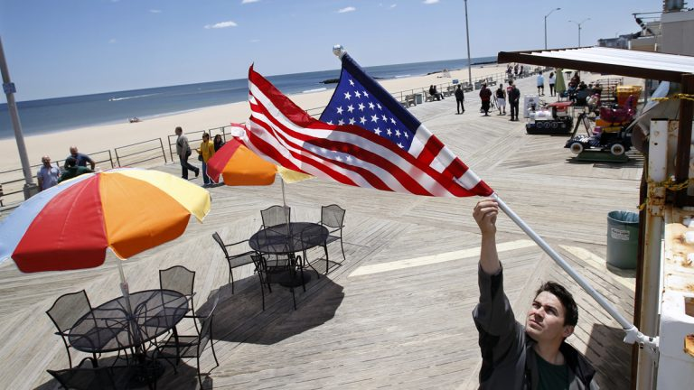 A boardwalk restaurant in Asbury Park, N.J., where one of Marilyn Schlossbach's businesses is located, opens on a recent Sunday morning. While Superstorm Sandy recovery continues, the Jersey Shore to a large extent has been cleaned up, rebuilt, and reopened. (AP Photo/Mel Evans)