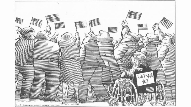A Tony Auth cartoon, dated 1991, showing a row of people standing at a parade, waving small American flags, blocking the view of a Vietnam vet in a wheelchair.