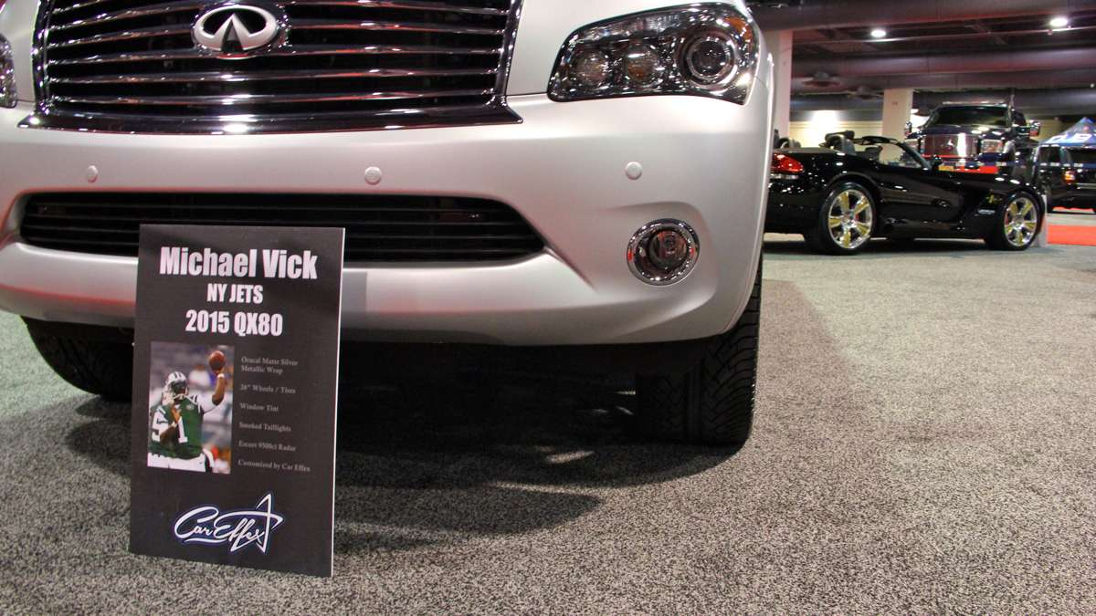 Michael Vick's customized SUV and the cars of other celebrities can be seen at the Philadelphia Auto Show. (Emma Lee/WHYY)