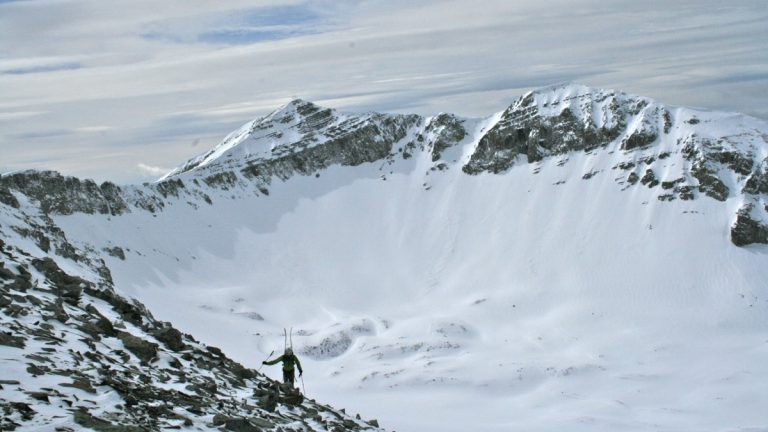 A lone skier climbs Cedar Peak, just outside of Big Sky, Montana. (Jerry Johnson/MSU Snow and Avalanche Lab)