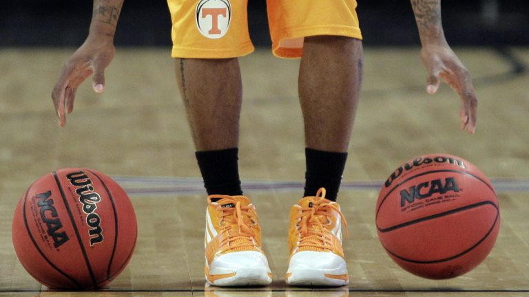 A Tennessee NCAA player bounces two basketballs during practice. (Elise Amendola/AP Photo)