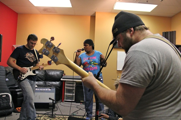 <p><p>Article 15members (from left) Brian McNally, Ericka Glenn and Frank Slater practice at the School of Rock in Cherry Hill. (Emma Lee/for NewsWorks)</p></p>