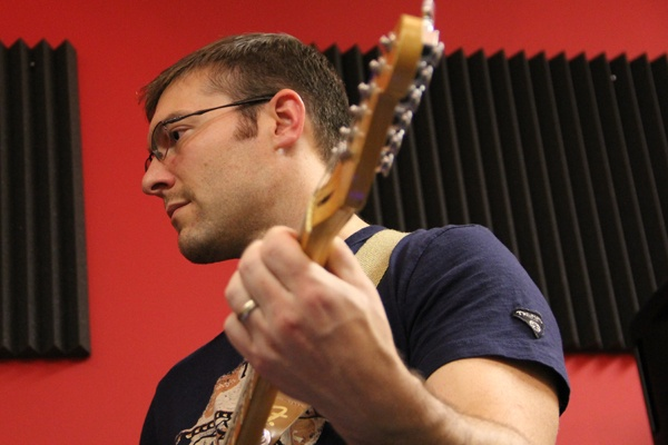 <p><p>Brian McNally plays guitar with his Article 15 band matesduring a rehearsal in Cherry Hill. (Emma Lee/for NewsWorks)</p></p>