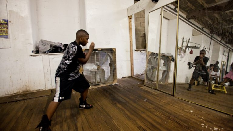 James Barnett warms up for a day of training at Bozy's Dungeon boxing gym in East Germantown. (Brad Larrison/for NewsWorks)