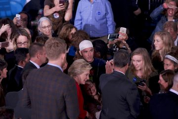 Jonathan Lee Riches is seen in close proximity to Democratic presidential nominee Hillary Clinton as she greets and takes selfies with voters after an Oct. 4, 2016, Family Town Hall in Haverford, Pennsylvania. (Bastiaan Slabbers for NewsWorks)