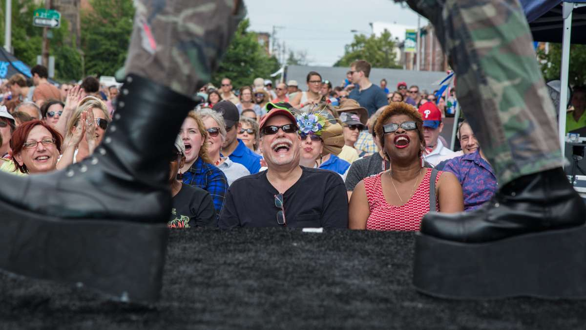 Audience members react to a performance by Attic Youth at the annual Bastille Day celebration at Eastern State Penitentiary