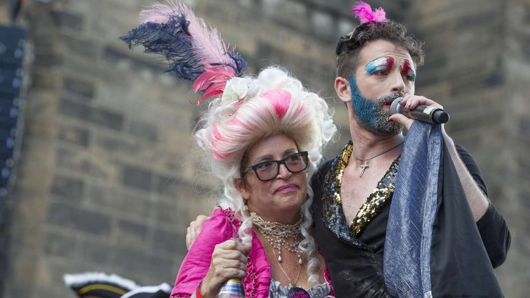 At the conclusion of the Bastille Day performance, 'Marie Antoinette' and 'Edith Piaf' make amends, sparing Antoinette the guillotine.