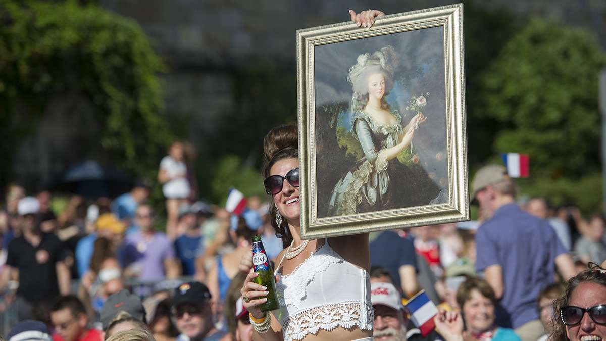 During the Bastille Day performance, Sandy Korenkiewicz holds up a portrait of Marie Antoinette
