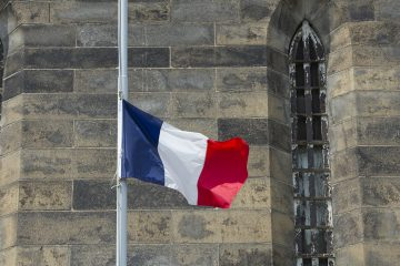Honoring the victims of the Nice terrorist attack the French flag was lowered to half-staff.(Jonathan Wilson for Newsworks)