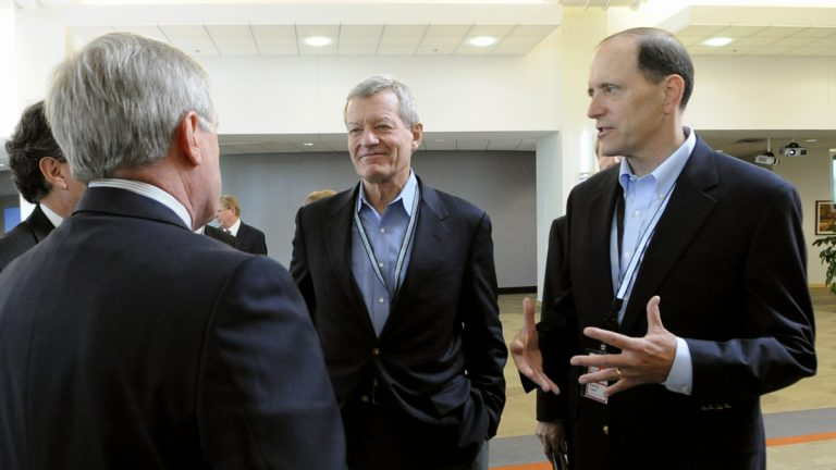 Senate Finance Committee Chairman Sen. Max Baucus, D-Mont., left, and the House Ways and Means Committee Chairman, Rep. Dave Camp, R-Mich., talk about tax reform to 3M executives in Maplewood, Minn., on their tour of the country to rally support for their effort to overhaul the nation's tax laws. (AP Photo/Hannah Foslien, File)