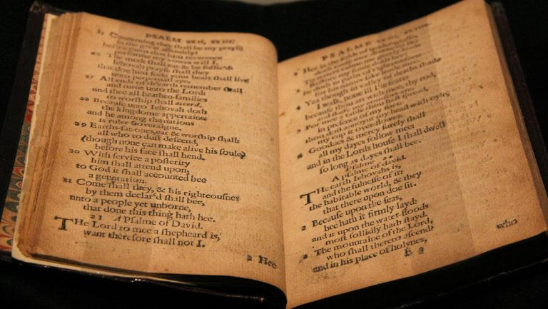 The first book printed in America, The Bay Psalm Book, is on display at the Rosenbach Museum. This copy, owned by Old South Church in Boston, will be auctioned in November and could raise as much as $30 million. (Emma Lee/for NewsWorks)