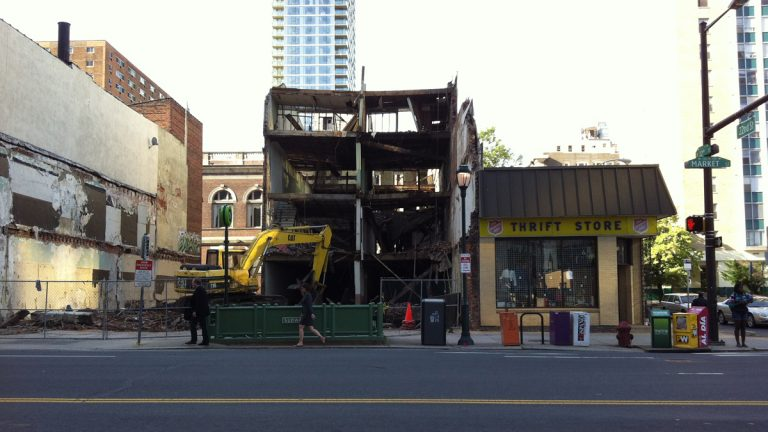 The four-story building being demolished before it collapsed onto the Salvation Army Thrift Store, Wednesday morning, June 5, 2013.  Six people are dead and at least 14 others were injured in the Center City collapse. (AP Photo/Luis Cornejo)