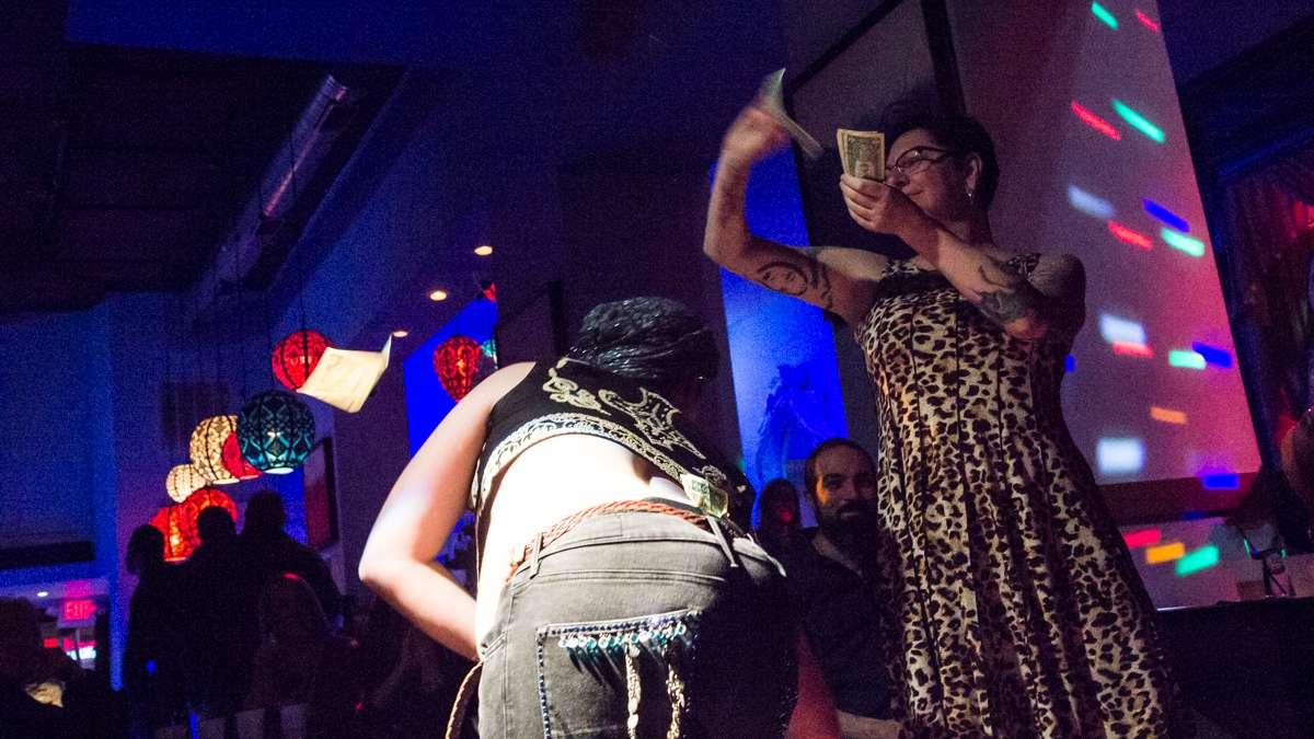 Dancer Roberto Mejía has money rained on him at the 5th annual Belly Dancers Fight for Air.